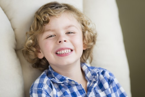 Blonde Boy Smiling in Chair for Nitrous Oxide