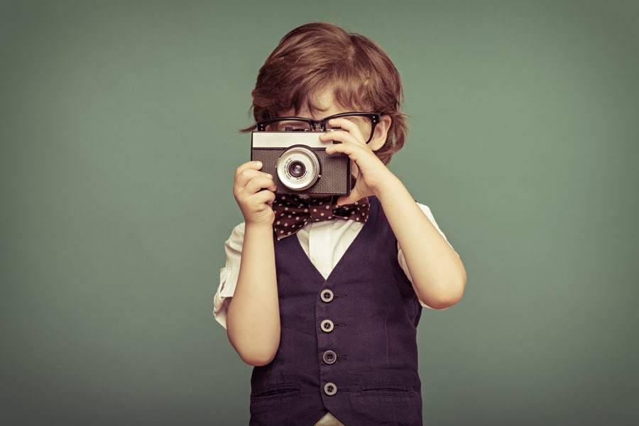 Child with old camera - Smiling in Photographs